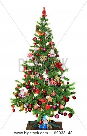 Green Christmas (chrismas) Tree With Shinny Colored Ornaments, Globes And Candy Sticks, Isolated