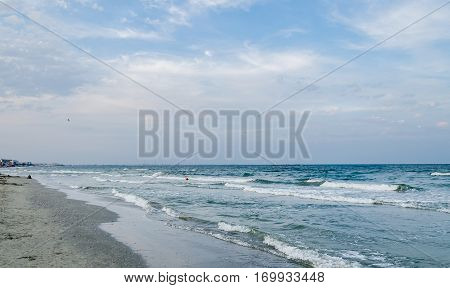 The Black Sea Shore, Sea Side With Sand, Water And Blue Sky