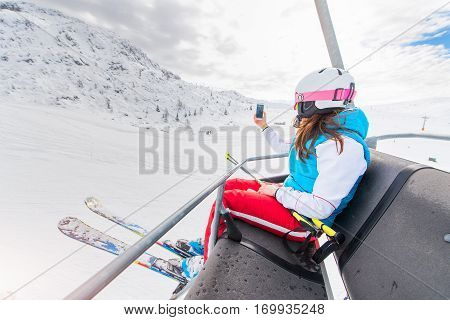 Girl Skier Chairlift Gets A Selfie