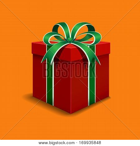 Festive gift box red. Tied with green ribbon with a bow on top.