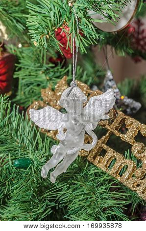 Detail Of Green Christmas (chrismas) Tree With Colored Ornaments, Angel