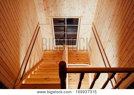 staircase and handrails inside of wooden house