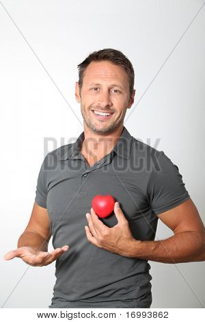 Man holding red heart in his hands