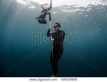Free diver performing warm up dive - static apnea on the depth