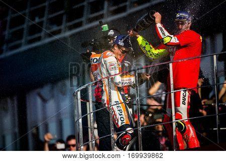 VALENCIA, SPAIN - NOV 13: (L) Marquez (R) Iannone during Motogp Grand Prix of the Comunidad Valencia on November 13, 2016 in Valencia, Spain.