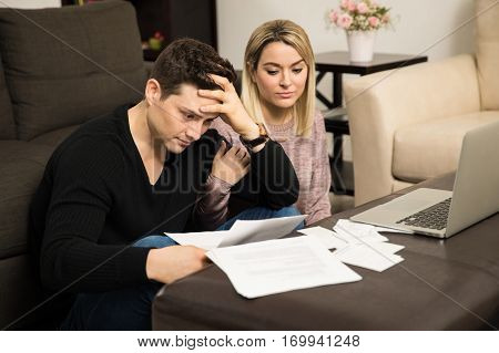 Stressed Couple Dealing With Their Finances