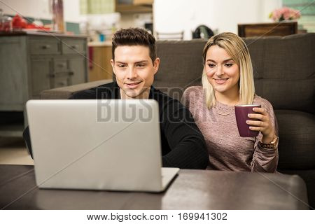 Cute Couple Watching Show On A Laptop