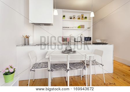 A Bright Kitchenette Module With Dining Table