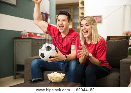 Excited Soccer Fans Watching Game