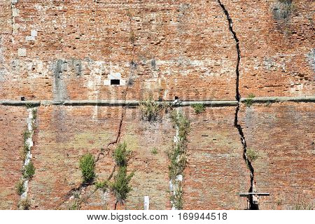 Cracked brick wall - Deep crack in a brick wall