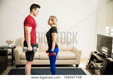 Couple Training And Lifting Weights Together