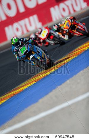 VALENCIA, SPAIN - NOV 12: 21 Morbidelli, 7 Baldassarri, 60 Simon in Moto2 Qualifying during Motogp Grand Prix of the Comunidad Valencia on November 12, 2016 in Valencia, Spain.