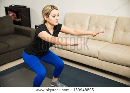 Pretty Girl Doing Some Squats At Home