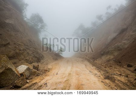 Foggy road. Offroad. Track. Fog. Mystical way. Dirty way