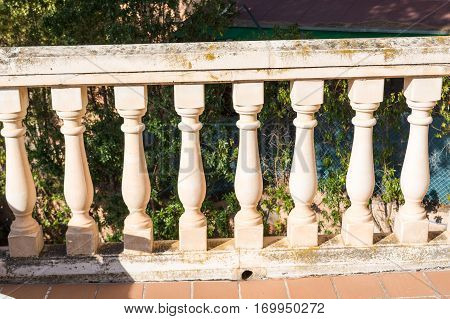 Nice antik old balustrades on a balcony
