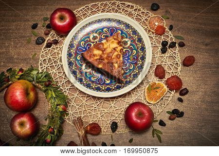 Delicious Apple pie baked at home. Sweet pie stuffed with apples. Apple cake on the table culinary skills. Favorite dish of children