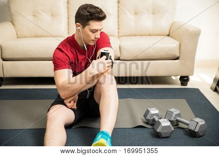 Man Choosing The Right Song For His Workout