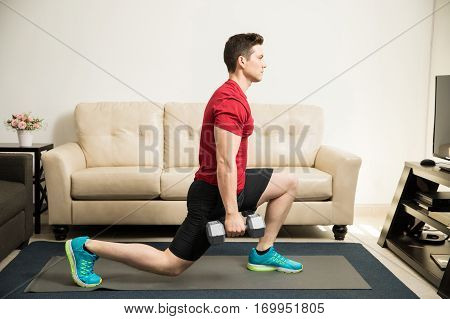 Man Doing Kneeling Lunges With Weights