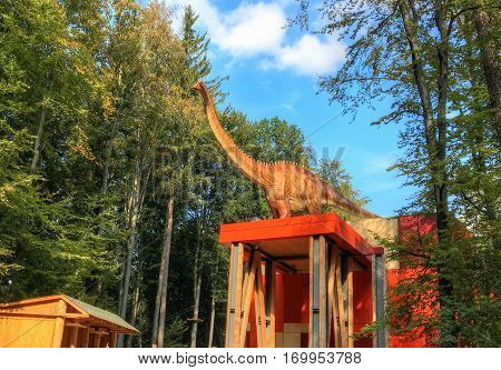 Rasnov, Romania - 12 June, 2015: Big dinosaur at the main gate of entrance in Dino Park, on the opening day