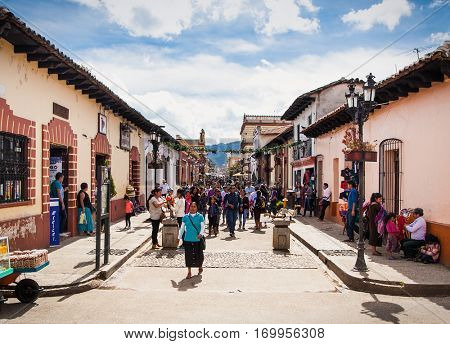 SAN CRISTOBAL, MEXICO-DEC 13, 2015:Tzotzil Maya people at main waking street of San Cristobal de las casas on Dec 13, 2015, Chiapas region, Mexico