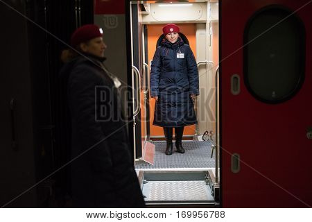 A Woman Train Conductor Standing On The Platform