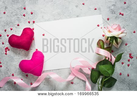 Valentines day background. Postcard confession of love. Two hearts ribbon and flower.