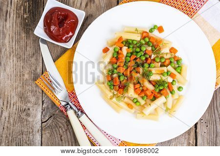 Rigatoni Pasta with vegetables in white plate. Studio Photo