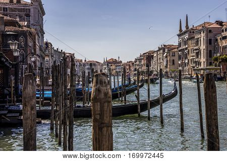 Grand Canal at one summer day, mooring gondolas at berthes, Venice, Italy