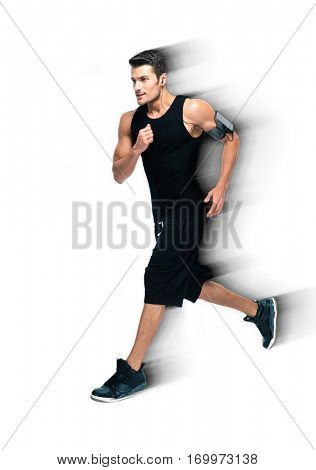Full length portrait of a handsome sports man running isolated on a white background