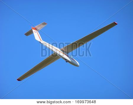 Photo of a white glider flying in the sky