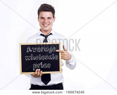 Average Wholesale Price - Young Smiling Businessman Holding Chalkboard With Text