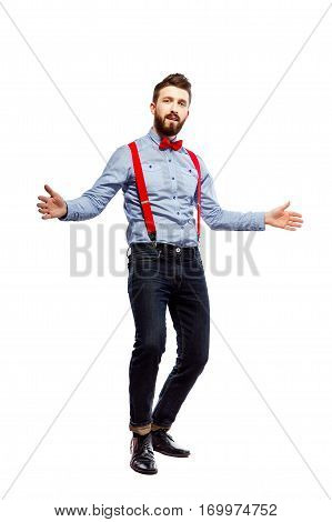stylish guy in the blue shirt with red bowtie and suspenders isolated on white. dancing, gesturing