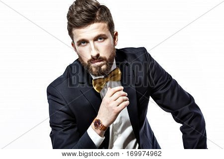 Elegant young handsome man in black classic costume. Studio fashion portrait. Isolated on white.