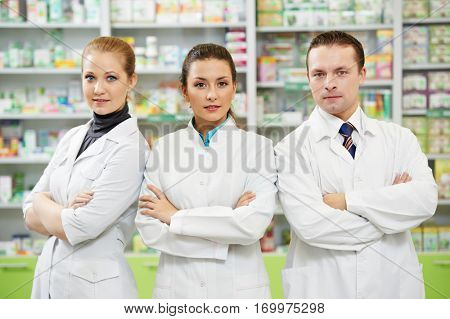 pharmaceutist woman and man workers in drug store