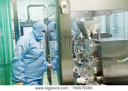 pharmaceutical production. factory worker
