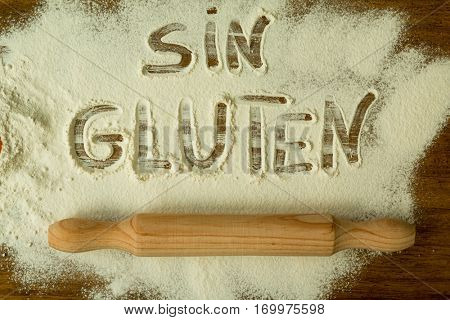 Flour on the table with writted word SIN GLUTEN