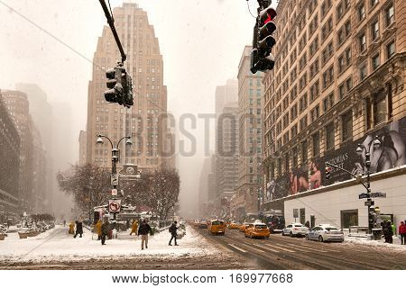 Street scene of midtown Manhattan Herald Square getting hit by snow storm Niko on February 9th, 2017.