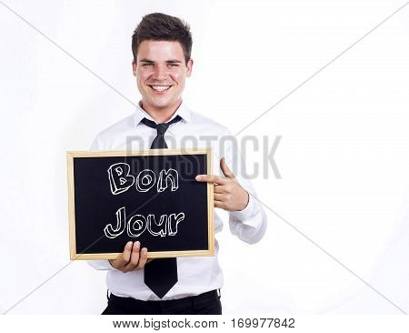Bon Jour - Young Smiling Businessman Holding Chalkboard With Text