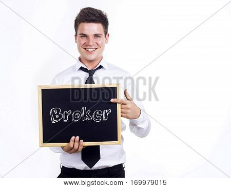 Broker - Young Smiling Businessman Holding Chalkboard With Text