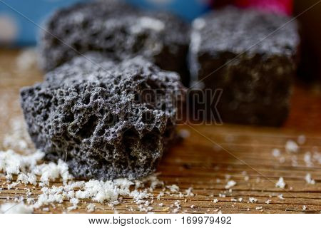 closeup of some pieces of candy coal on a rustic wooden table