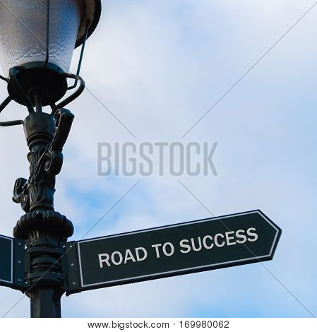 Road To Success Directional Sign On Guidepost