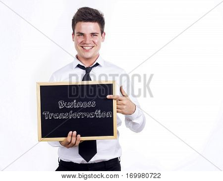 Business Transformation - Young Smiling Businessman Holding Chalkboard With Text