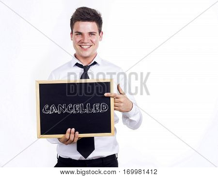 Cancelled - Young Smiling Businessman Holding Chalkboard With Text