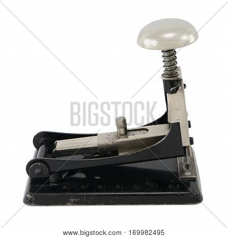 Old-fashioned black metal stapler isolated on white.