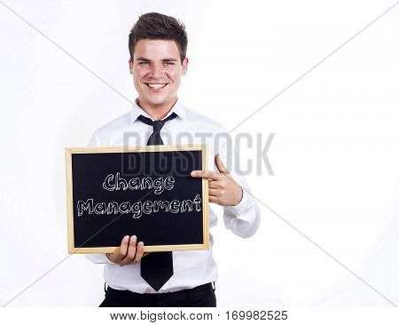 Change Management - Young Smiling Businessman Holding Chalkboard With Text