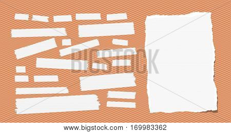 Sticky, adhesive masking tape, ripped note paper stuck on squared orange background.