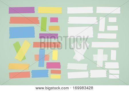 Different size colorful and white sticky paper, adhesive, masking tape stuck on green background.