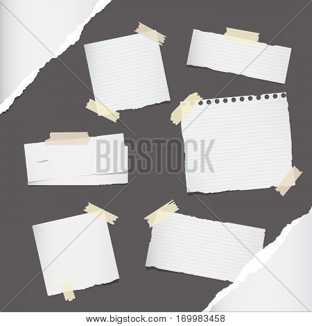 Different size ruled white note, notebook, copybook paper sheets stuck with sticky tape on dark gray background.