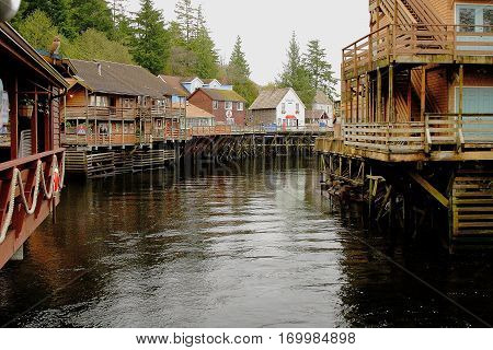 Ketchikan Alaska wooden buildings along meandering waterway