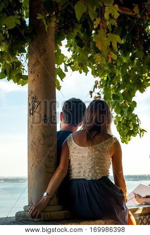 Lisbon, Portugal - Septmember 19, 2016: A couple enjoying the beautiful scenery, the vista from the viewpoint Santa Luzia